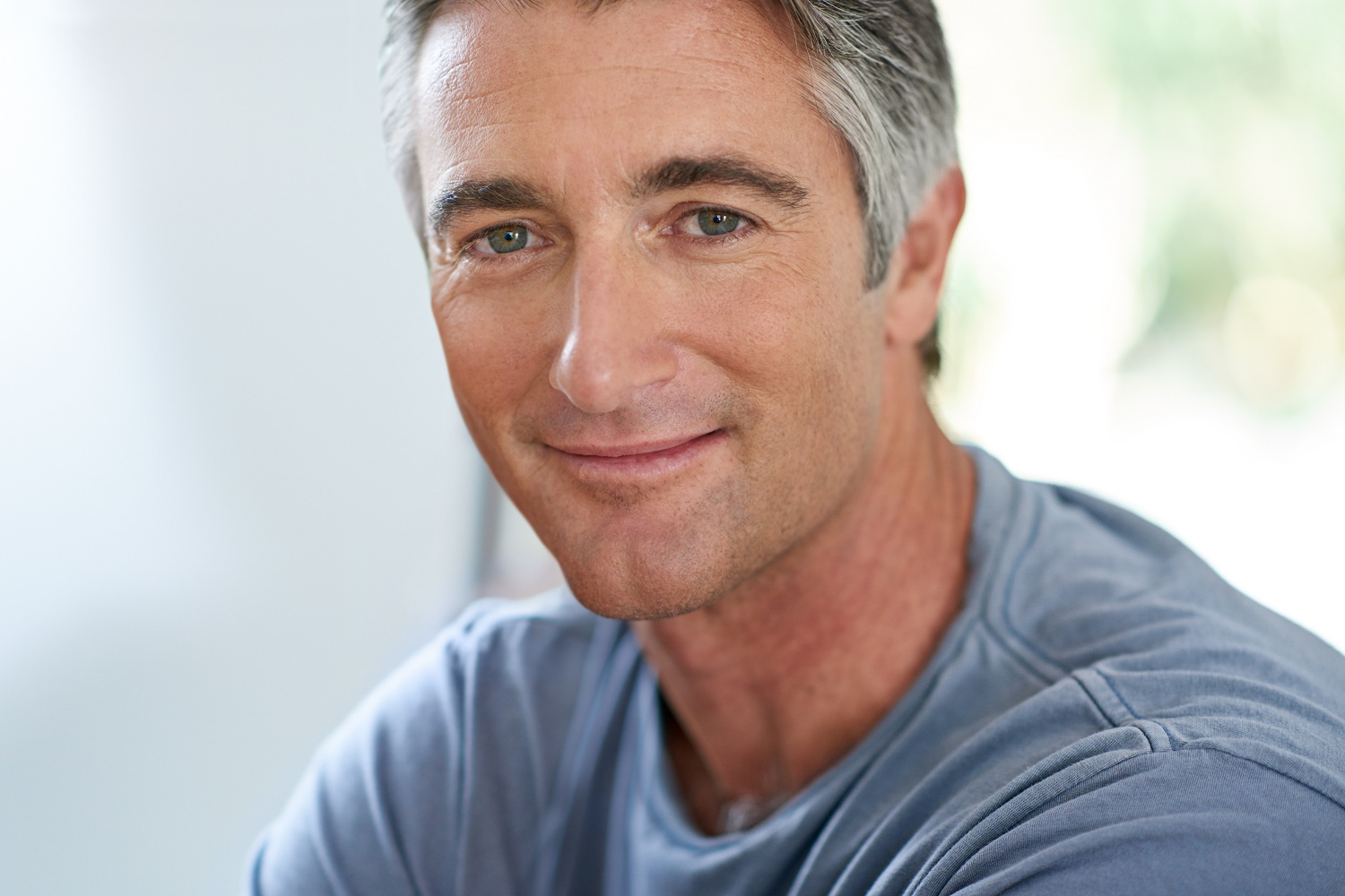 handsome mature man relaxing at home